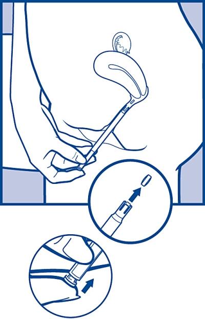 För att lösgöra tabletten, tryck lätt på tryckknappen tills du känner ett klick.