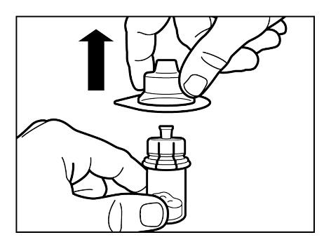 Lyft av förpackningen från flaskadaptern.