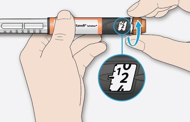 Välj 2 enheter genom att vrida dosväljaren tills dosmarkören pekar på 2