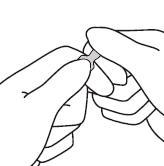 Håll ampulltoppen med en hand med pekfingret mot ampullhalsen och tummen på den färgade pricken