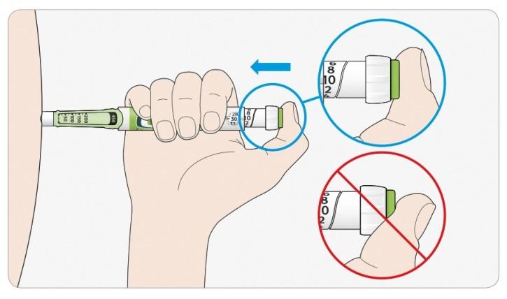 Placera tummen på injektionsknappen. Tryck sedan in den helt och håll kvar