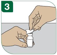 Tvätta injektionsflaskans ovansida med en spritsudd