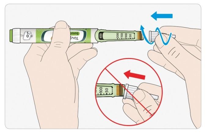 Håll nålen rakt och skruva fast den på pennan. Dra inte åt för hårt.