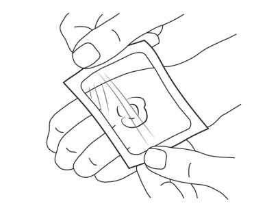4. Placera försiktigt förbandet över klicken med kräm.