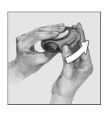 Bilden visar hur man håller Diskus och för fram spaken