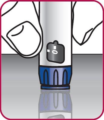 """Tryck injektionsknappen mot en plan yta, t.ex. en bordsyta, tills """"0"""" är i linje med skåran i doseringsfönstret."""