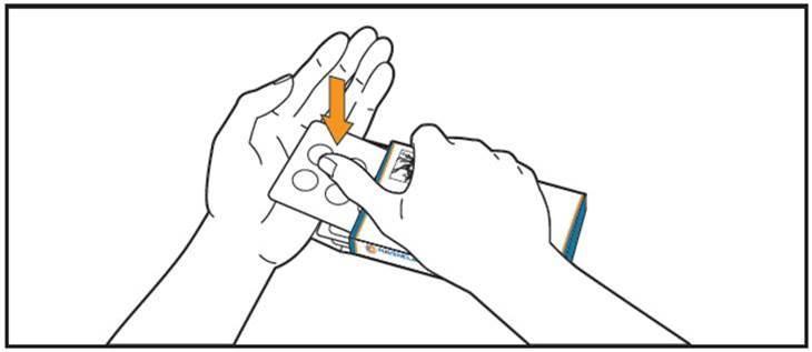 En eller två tabletter trycks ut i handen