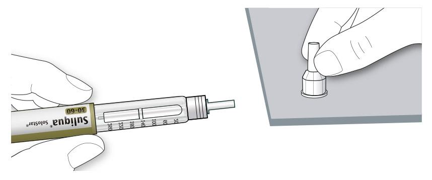 Bilden visar hur du drar av det yttre nålskyddet