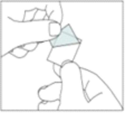 Bilden beskriver hur man drar bort baksidan vid pilen