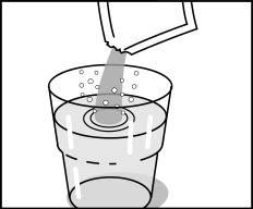 Glas med vatten och brusgranulat