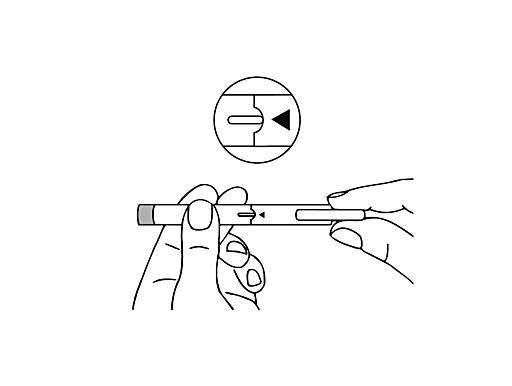 Bilden visar hur skyddshylsan sätts tillbaka på pennan.