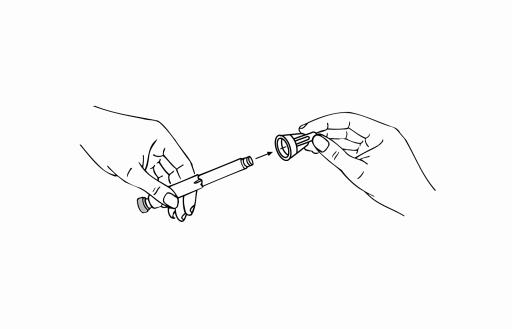 Bilden visar hur man lyfter av den skyddade injektionsnålen.