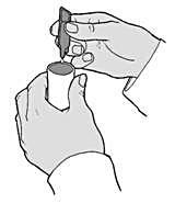 Bilden visar på att man trycker ut all vätska som finns i endosbehållaren ner i nebulisatorbehållaren